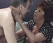 Extremely horny redhead grandma indulging in lustful foreplay thrill