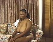 A solo black babe with massive mammaries